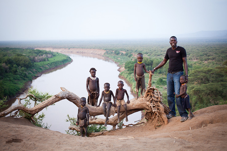Lale with Kara children on the Omo River in the village of Korcho